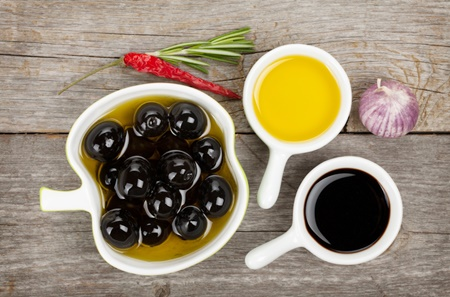Olives, olive oil and vinegar with spices